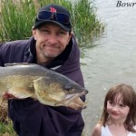 Daddy and daughter fishing in Alberta