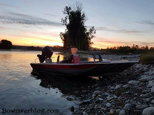 Explorer industries jet boat rests on the bank of the bow river Alberta
