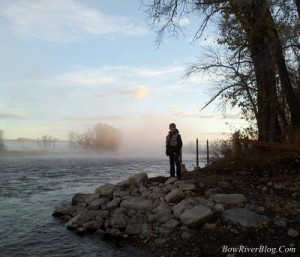 A dence fog rises along the river banks of the Bow River